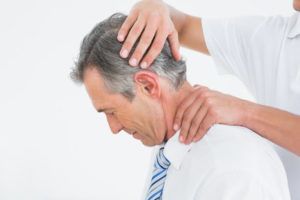 chiropractor working on man's neck