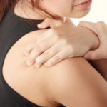 woman with aching shoulder